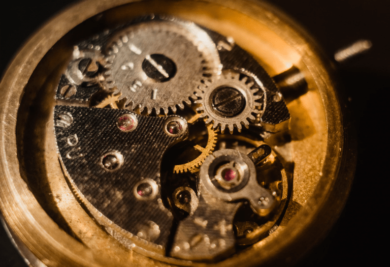 photo of gears in a wrist watch