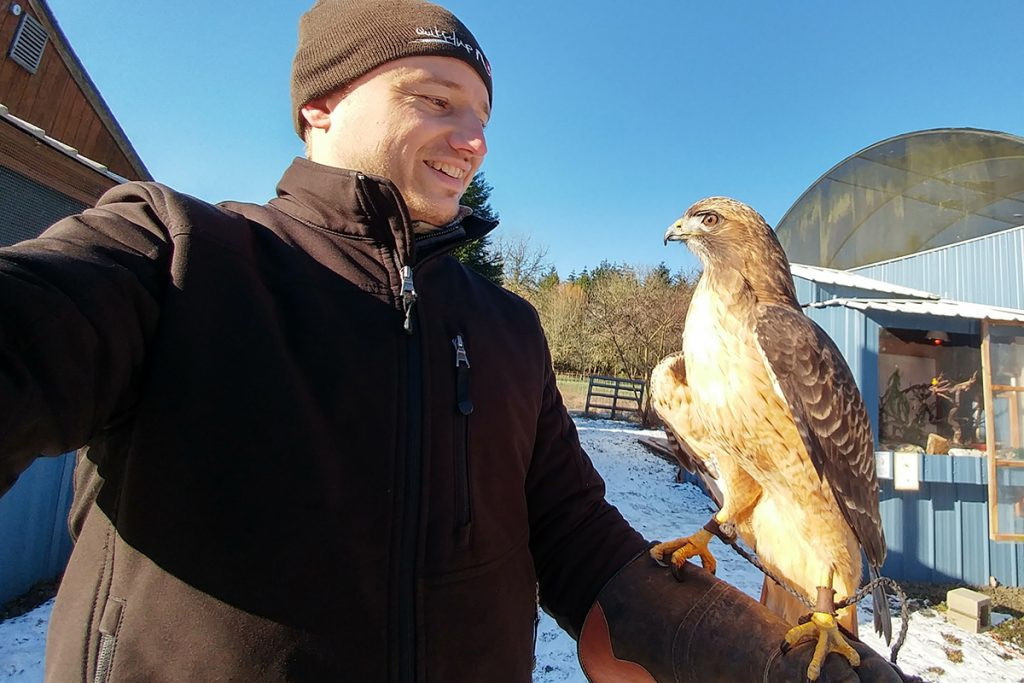 Jon holding Red Tail Hawk