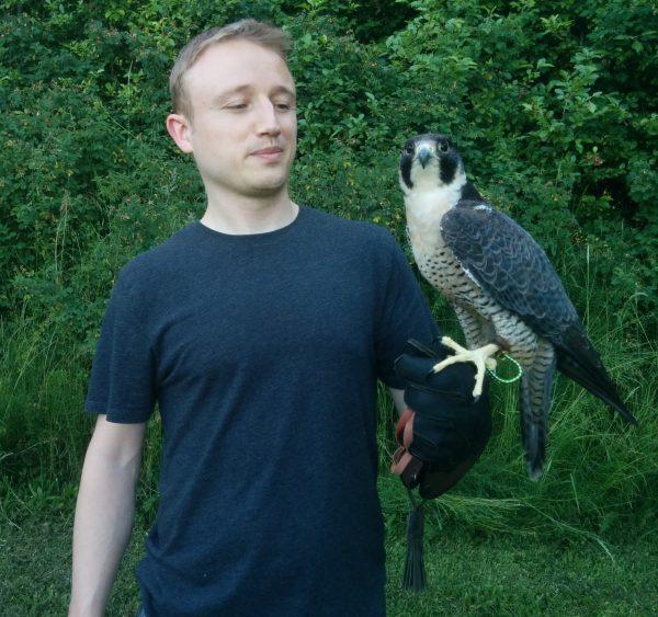 Jon Perry holding a hawk